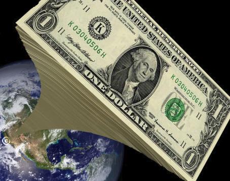 planète Terre avec une pile géante de billets de dollars